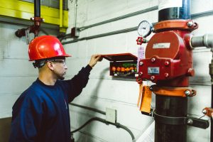 technician inspecting a fire protection system