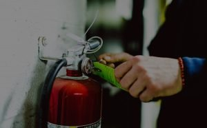 checking a fire extinguisher